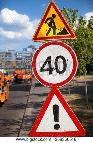 Road Work (roadwork), Speed Limit (40 Kilometers Per Hour) And Attention: Other Dangers Traffic Sign