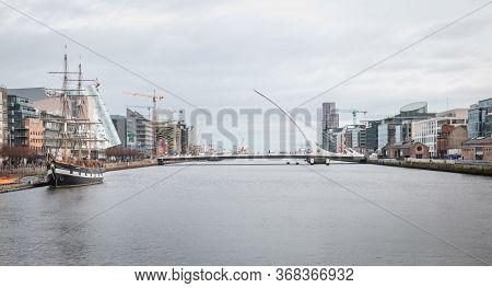 River Liffey With Sailboat Jeanie Johnston And The Samuel Beckett Bridge In Dublin
