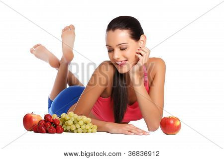 Hungry Brunette Teenager With Healthy Fruits