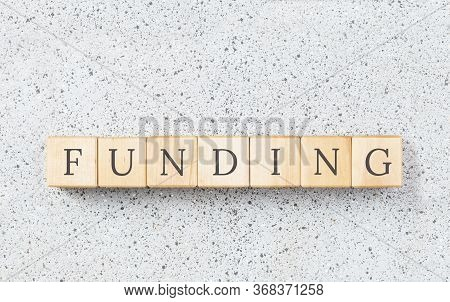 Funding Text On Wooden Blocks On Grey Textured Background. Small Business Funding Oportunities, Borr