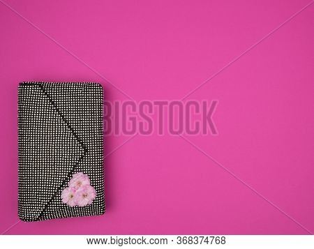 Womens Stylish Handbag With Spring Almond Flower On A Pink Background.