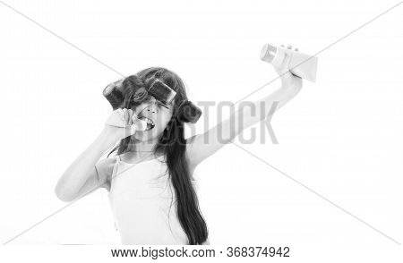 Kid Fashion, Cosmetics. Teen In Hair Curlers. Little Girl Is Holding A Tube For The Cream. Cute Teen