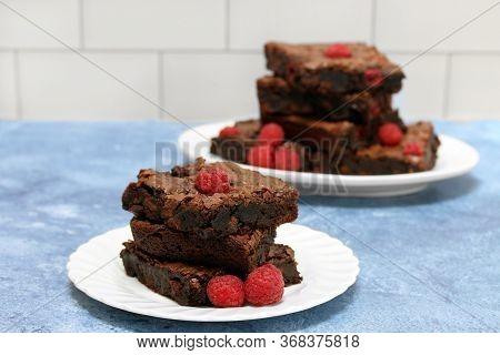 Raspberry Chocolate Fudge Brownies With Chunks Of Chocolate And Raspberries Baked In.