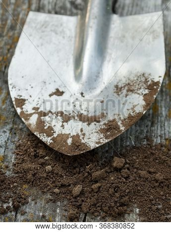 Metal Spade (shovel) And Black Earth (ground, Soil, Dirt). Agriculture. Farming.