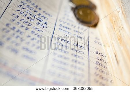 Hand-written Calculations And Coins. Bookkeeping (accounting). Economy. Financial Themes. Money Savi