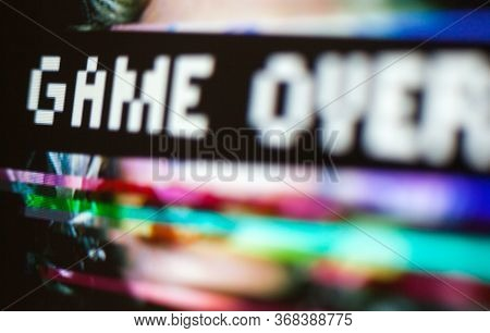 Game Over. Message On The Screen. Glitch Background. Woman's Face In The Background. Glitch Art. Dig