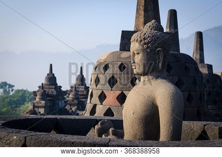 Stone Buddha Sculpture Enclosed In Bell Shaped Stupa Shrine On Top Of World Heritage Site Borobudur