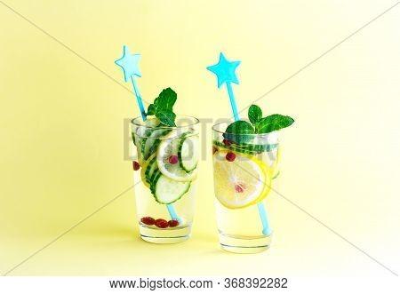 Sassy Diet Water. Cucumber, Lemon, Mint Lemonade In Glasses On Yellow Background