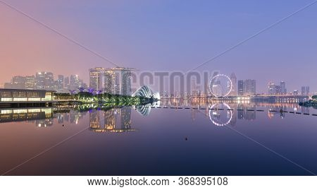 Singapore, 22 Oct 2017: Gardens By The Bay, The Marina Bay Sands Hotel And The Flyer Wheel Iconic La