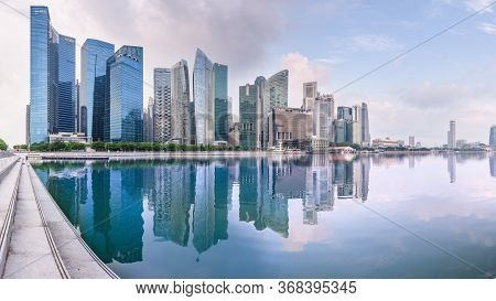 Singapore - 22 Oct 2017: The Central Business District Skyline Reflects In The Marina Bay Reservoir