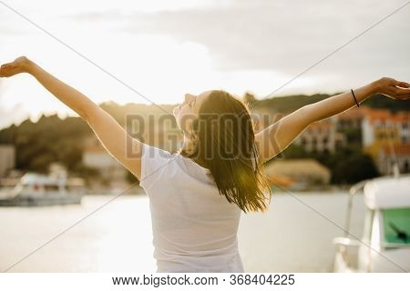Young Happy Woman Dancing Under The Sun.happiness.carefree Female Celebrating Success.romantic Woman