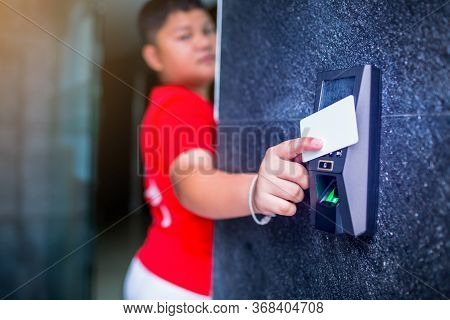 Door Access Control. Boy Holding A Key Card To Lock And Unlock Door At Home Or Condominium. Using El