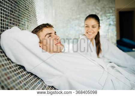 Young Couple Relaxing Inside Spa Bath Room.romantic Newlyweds Enjoying Honeymoon Vacation Day Doing