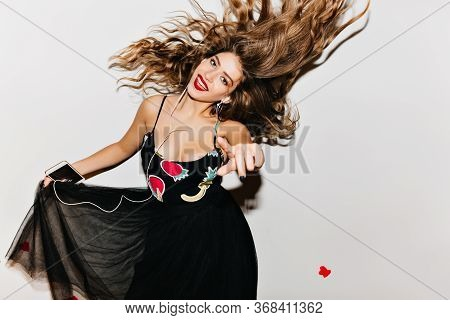 Amazing Caucasian Girl Dancing With Happy Smile. Fashionable Brunette Woman Expressing Energy During