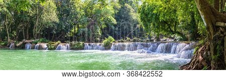 Waterfall In A Forest On The Mountain In Tropical Forest