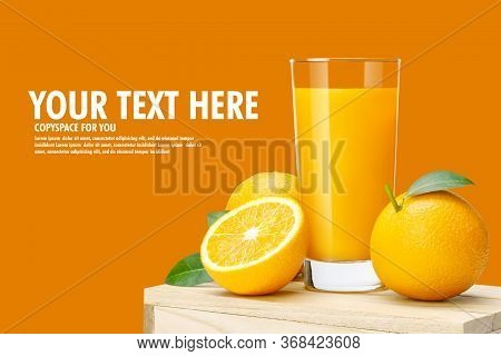 Glass Of Fresh Orange Juice On Wooden Box, Fresh Fruits Orange Juice In Glass With Group On Orange C