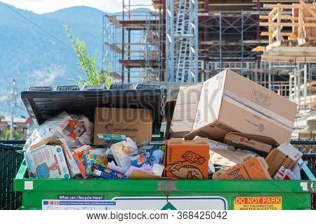 Penticton, British Columbia/canada - September 3, 2019: Close-up Of Trash Overflowing In Recycling D