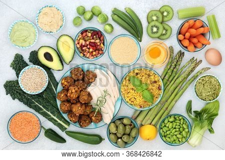 Healthy super food collection with immune boosting foods high in antioxidants, vitamins, minerals, protein, smart carbs, omega 3 & fibre. Flat lay.