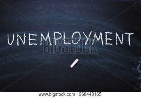 The Word Unemployment Written In Chalk. Concept Of Hiring