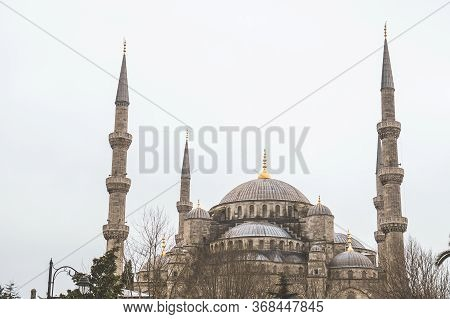 Blue Mosque In Istanbul Close Up. Sultanahmet Mosque In Gloomy Weather. The Main Entrance To The Blu