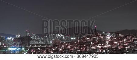 Building Of The City With Modern Buildings In Korea, Night View. Beautiful Landscape Of The City At