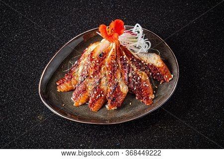 Japanese eel grilled or Unagi ibaraki set on plate in Japanese style with studio lighting