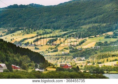 Byrkjelo Village, Sogn Og Fjordane County, Norway. Beautiful Sky Above Norwegian Rural Landscape. Be
