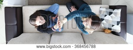 Girlfriends Are Sitting On Couch, Gesture Unity. Planning Joint Affairs With Girlfriend. Students Ar