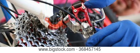 Professional Adjustment In Service Center Bike. An Experienced Specialist Is Able To Service Bike. M