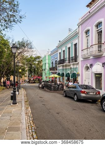 San Juan, Puerto Rico - April 29, 2019: Visitors Explore The Streets Of Old San Juan. Typical Vibran