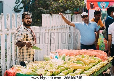 Anjuna, Goa, India - February 19, 2020: Man Seller Sells Traditional Indian Fried Maize Corn In The