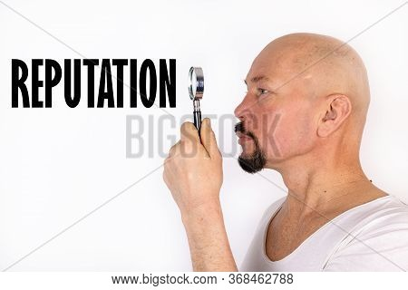 American Man Reads The Word, Text Reputation Through A Magnifying Glass, On A Light Background. Busi