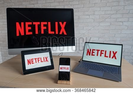 Netflix Logo On The Screens Of All Devices. Application For Watching Movies And Tv Shows Stream Righ