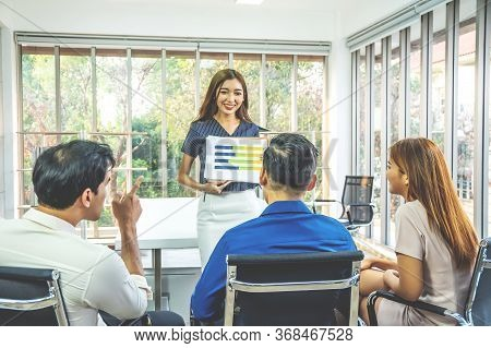 Businesswoman Standing And Leading Business Presentation. Female Executive Putting His Ideas During