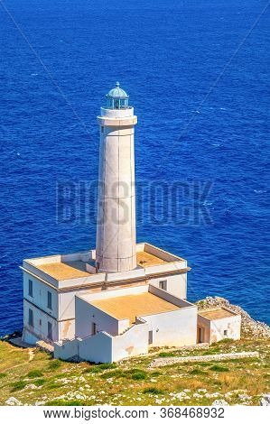 Vertical Background Of Lighthouse Overlooking The Sea In Italy