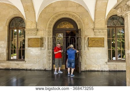 Gori, Georgia - June 14, 2016: Tourists Take Pictures Of The Entrance To The Stalin Museum