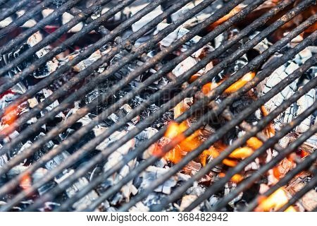 Empty Flaming Charcoal Grill With Open Fire, Ready For Steak Preparation Barbecue Concept With Selec