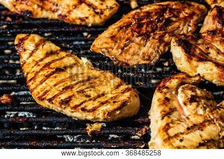 Chicken And Pork Steak Grilled On A Charcoal Barbeque. Top View Of Camping Tasty Barbecue, Food Conc