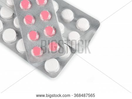 Pills Of Different Colours Lay On Table. Colorful Antibacterials Pills, Capsules Of Medicine. Pharma