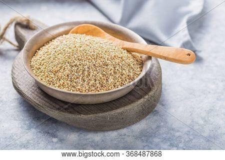 Raw  White  Quinoa Seeds (lat. Chenopodium Quinoa) On  Plate With Wooden Spoon White  Quinoa Seeds