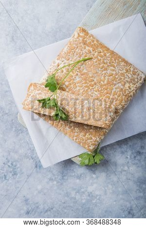 Slice Of Tempeh  Or Tempe Made Of Fermentation Process That Binds Soybeans, Is Traditional Food From