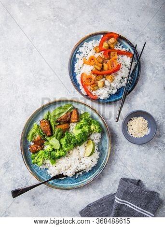 Vegan Buddha Bowls. Vegan Teryaki  Tempeh Or Tempe Buddha Bowls  With Rice, Steamed Broccoli, Spinac