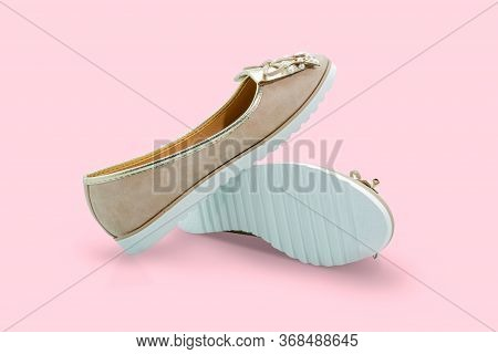 Brown Shoes On A Pink Background. Include The Clipping Path In Both Objects.