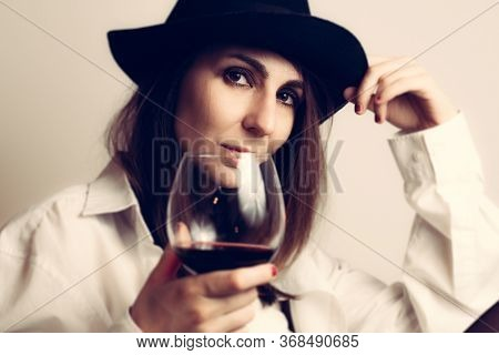 Beautiful Woman Portrait With Wine. Beauty Woman Face Portrait. Beautiful Model Woman Portrait. Styl