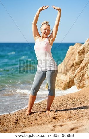 Mature Attractive Woman During Sports By The Sea