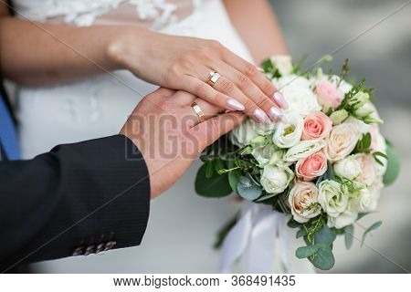 She Said Yes Concept With Flowers. Suited Up Man Fiance Groom Hands Stylish Platinum White Gold Prop