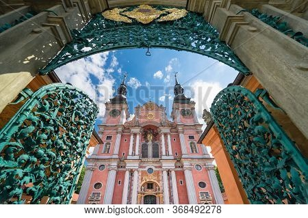 The Opened Magnificent Openwork Metal Entry Gate And Beautiful Facade Of Baroque Basilica Of The Vis