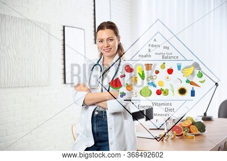 Nutritionist's Recommendations. Doctor Near Desk In Office