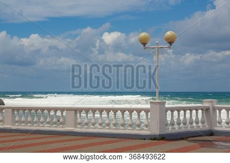 Embankment Of The Resort City Of Gelendzhik. Balustrade And Lights Of The Embankment Against The Bac