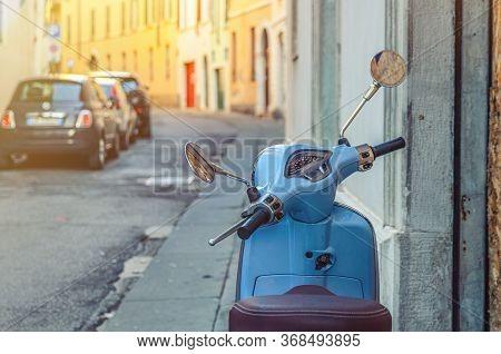 Brescia, Italy, September 11, 2019: Vintage Blue Scooter Motorbike Vespa In Narrow Italian Empty Str